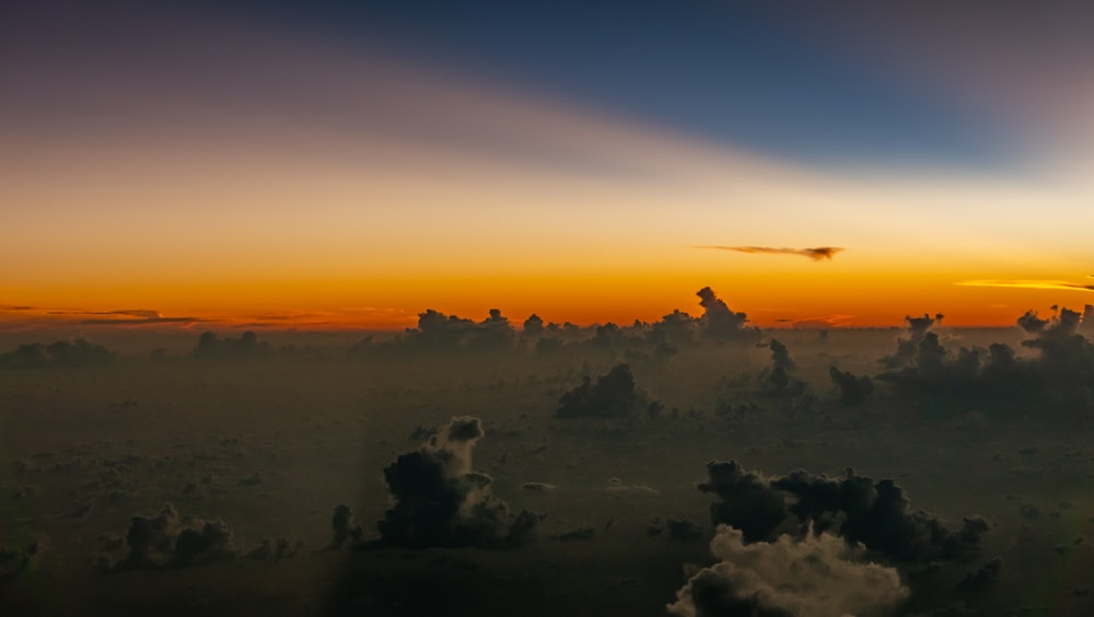 white and black clouds on the air under golden hour