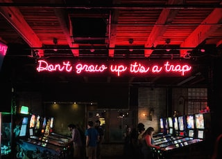 people playing on arcade