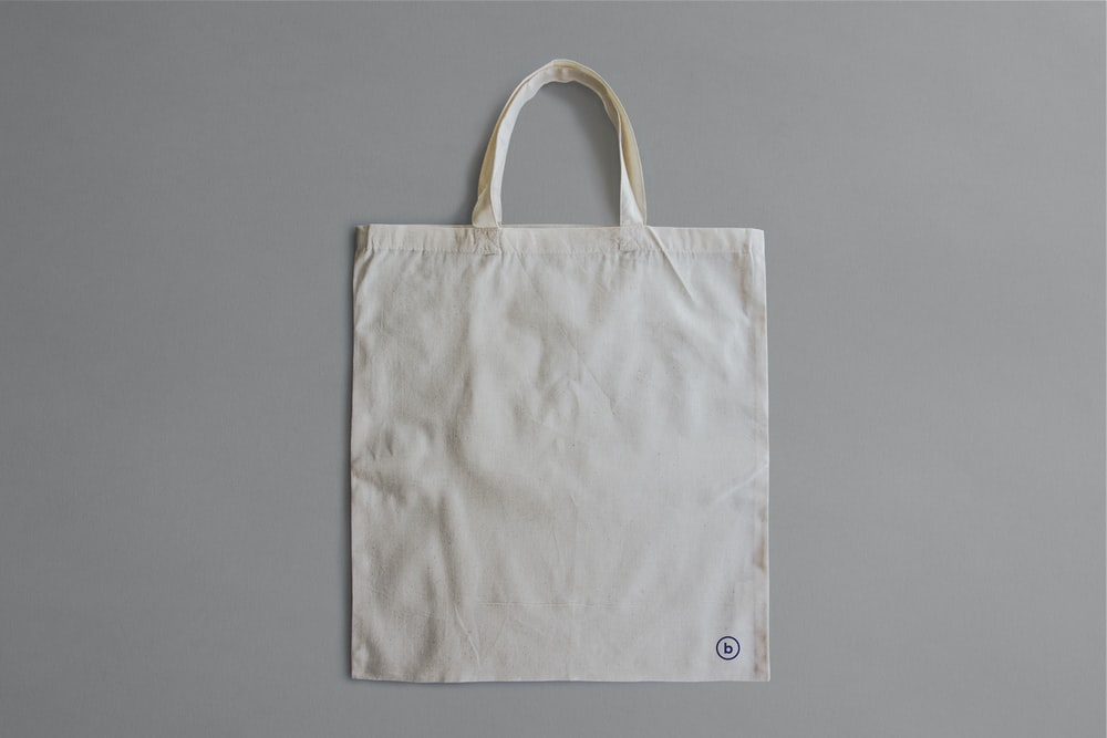 white reusable bag on gray surface
