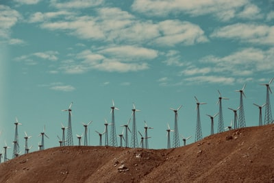 gray wind turbines under cloudy sky during daytime nevada zoom background
