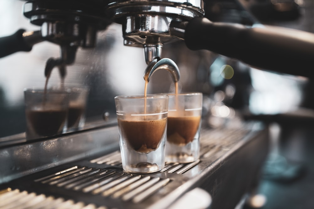coffee pouring into two clear glasses