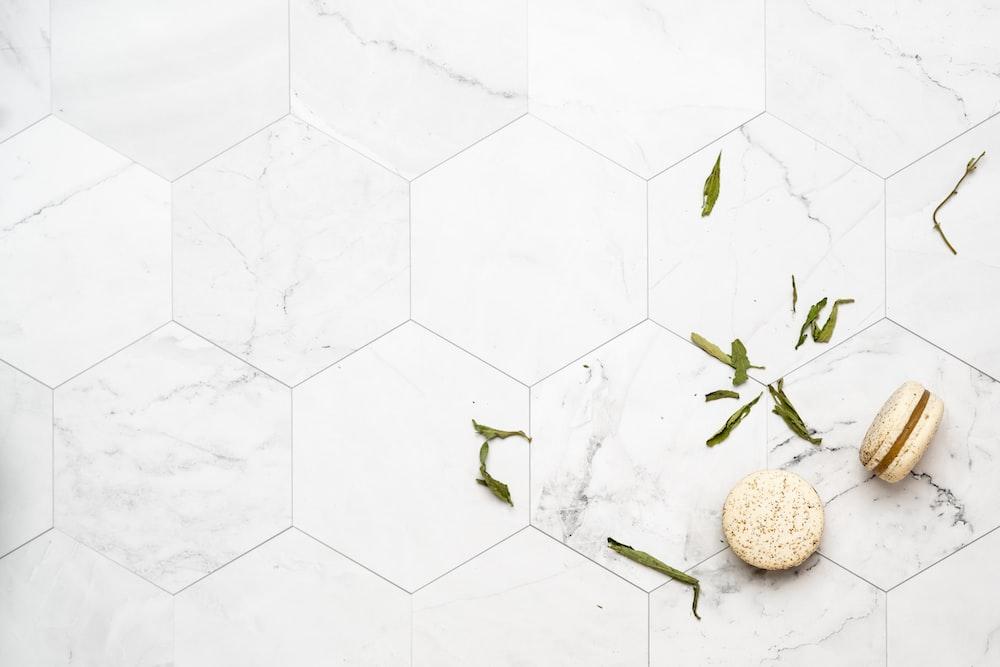 two round pastries on white tile floor