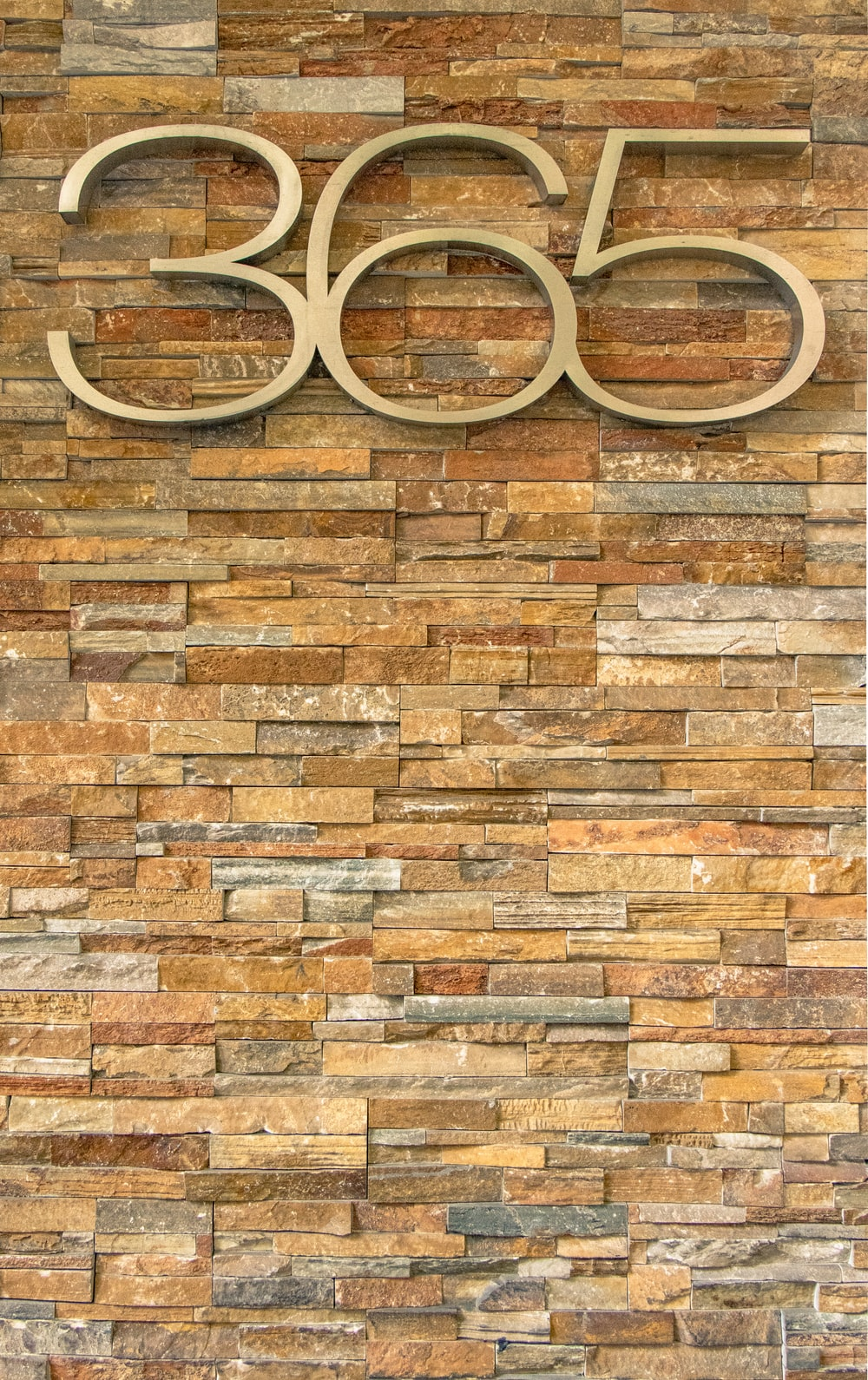 365 cutout number on brick wall