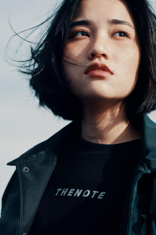woman wearing black crew-neck top