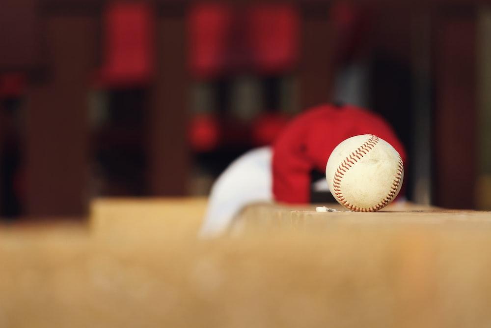 shallow focus photo of white baseball