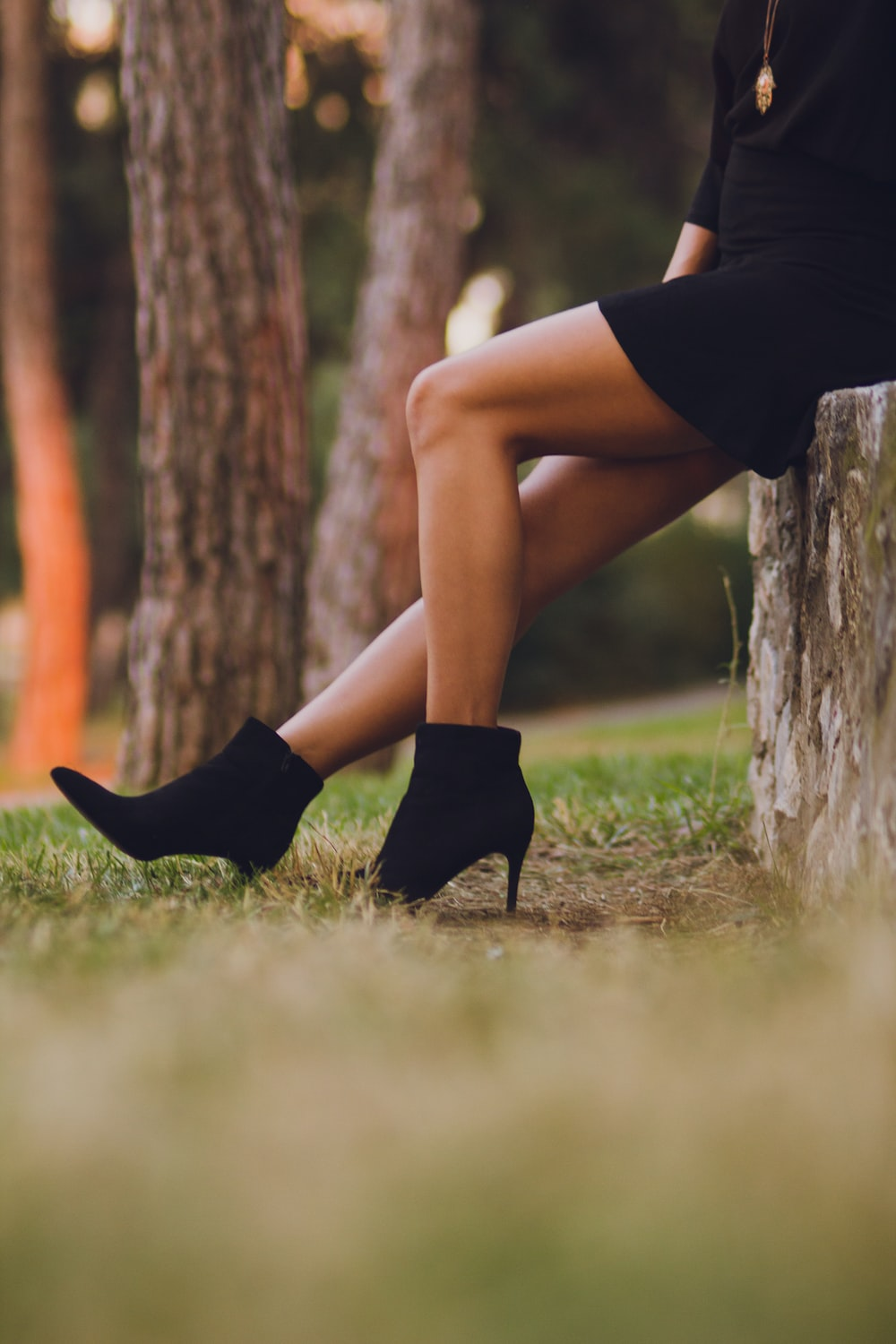 shallow focus photo of person in black booties
