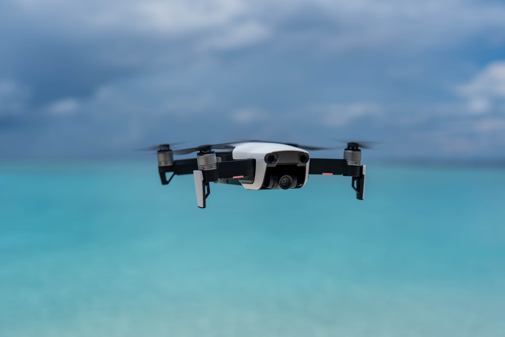 shallow focus photo of white and black drone