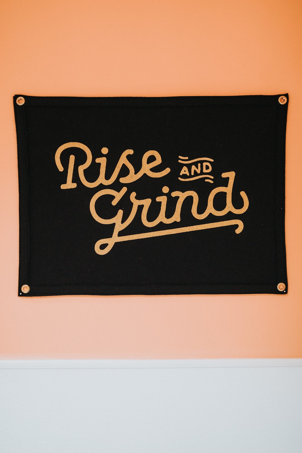 black rise and grind wall decor mounted on brown wall