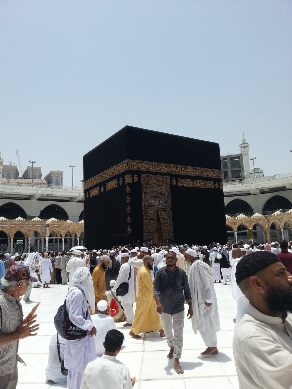photography of people gathering near Kaaba, Mecca, Saudi Arabia during daytime