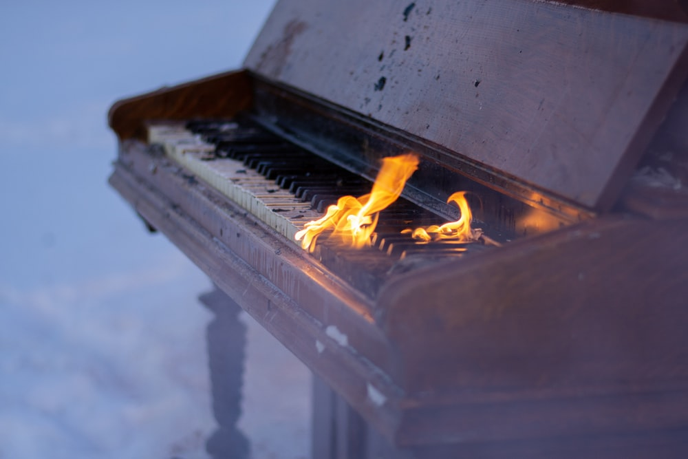 fire on brown piano