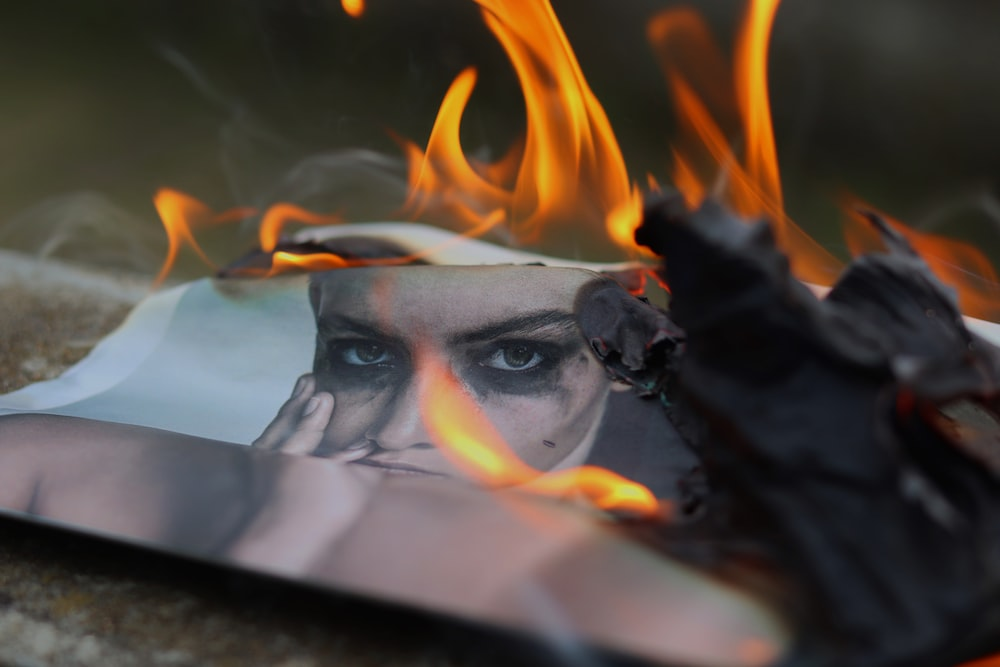 burning photo of person