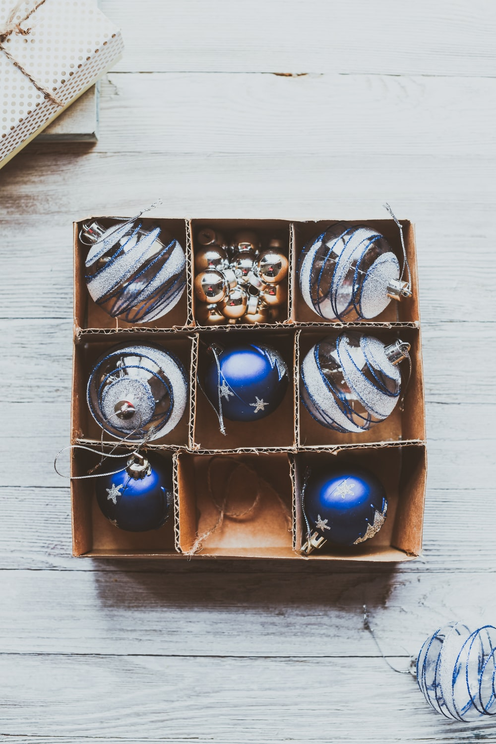 box of Bauble balls on white surface