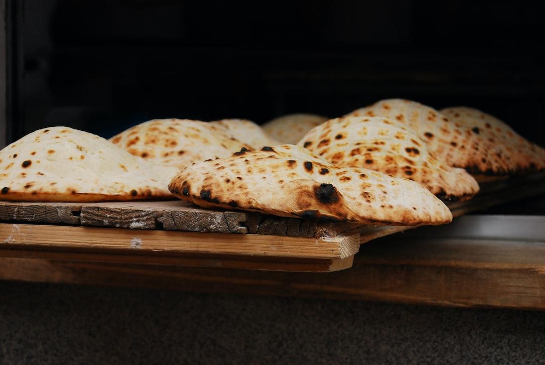 Flat-bread baked in an open fire oven, Serbian-style flatbread, Lepinja, Bosnia and Herzegovina, Sarajevo, fresh bread, warm bread