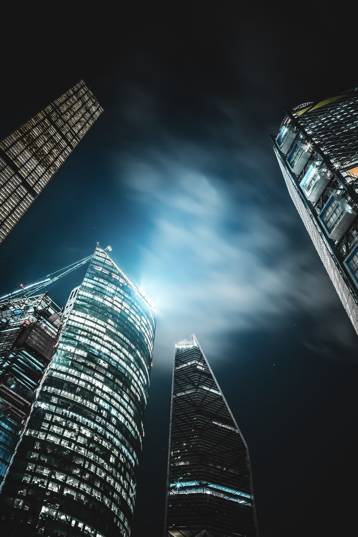 high-rise buildings under black sky