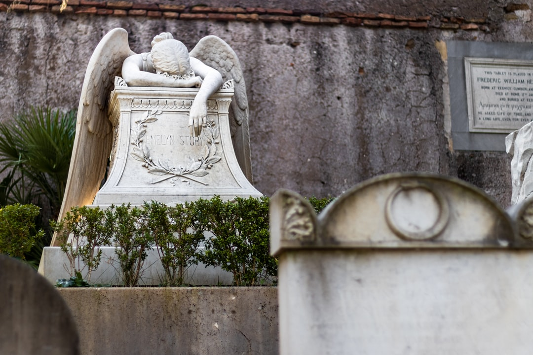 Tombstone of a fallen angel at the Protestant Cemetery, Rome, Italy