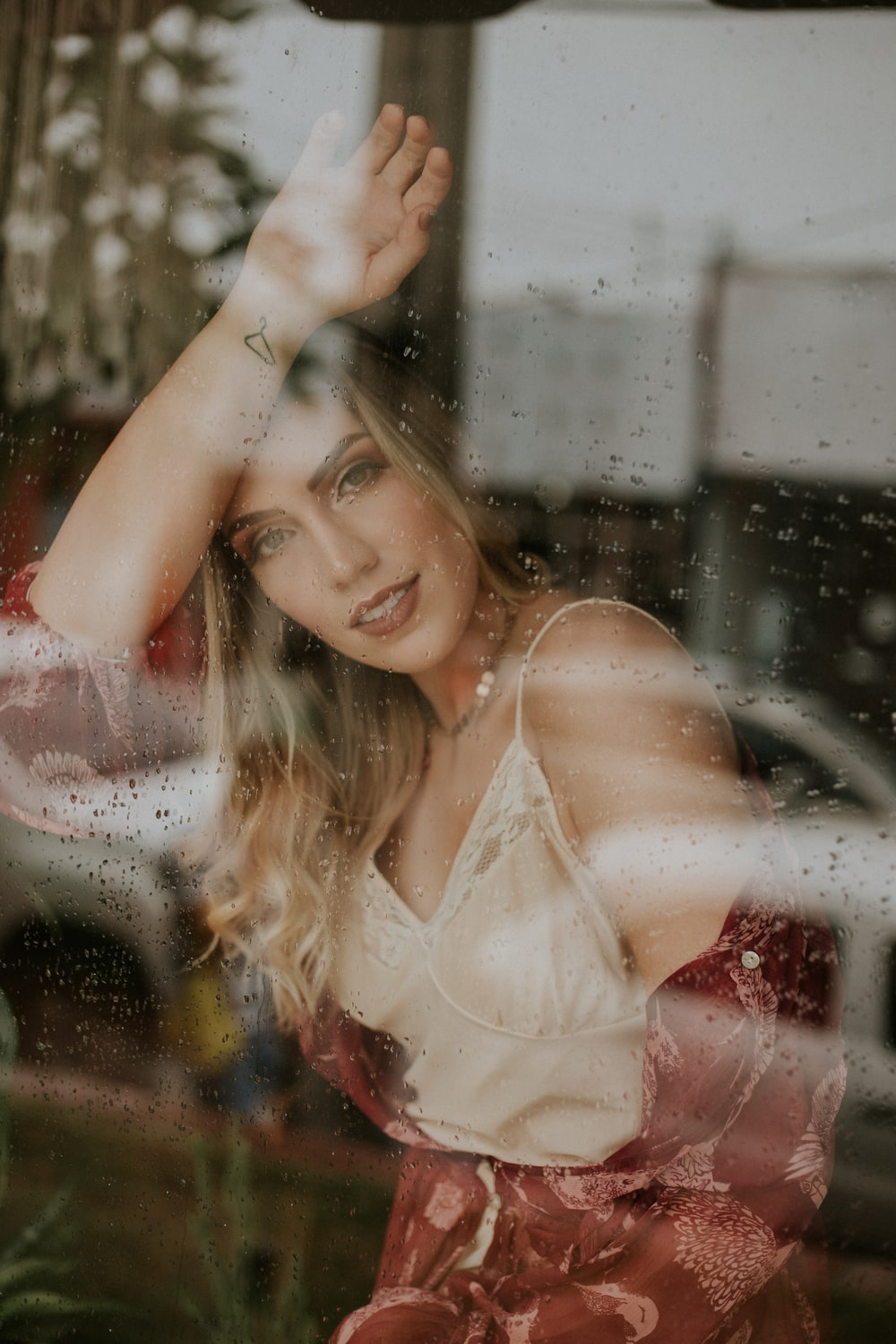 woman leaning on glass wall