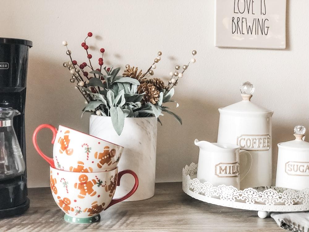 orange and white floral ceramic teacups