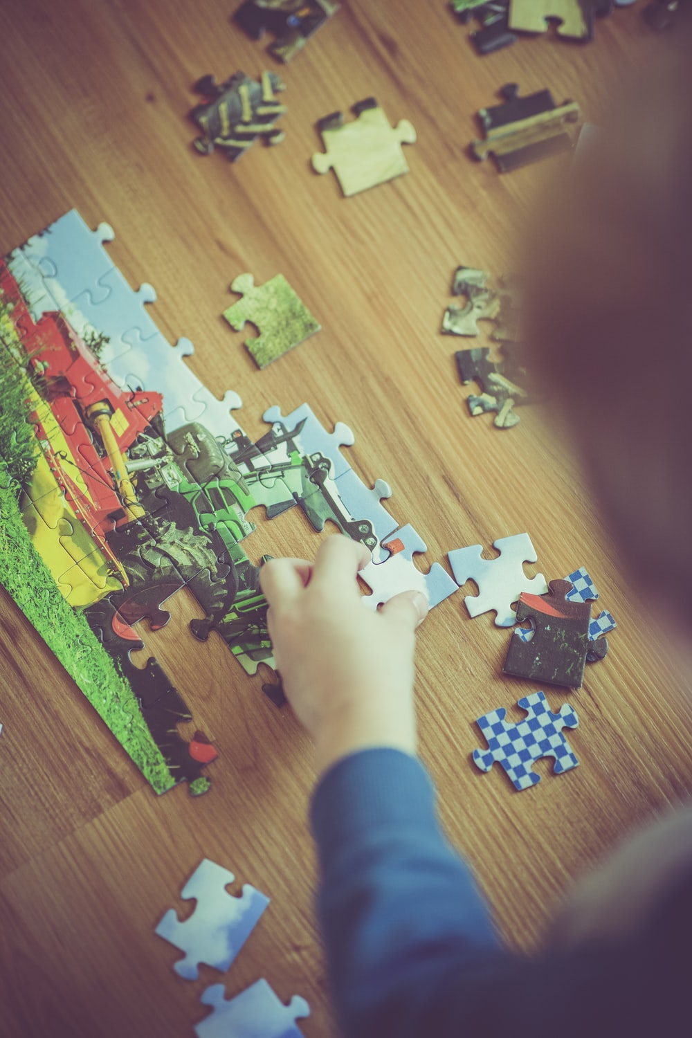 boy playing puzzle