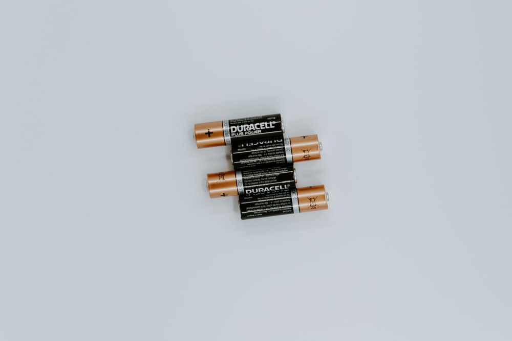 four black Duracell batteries