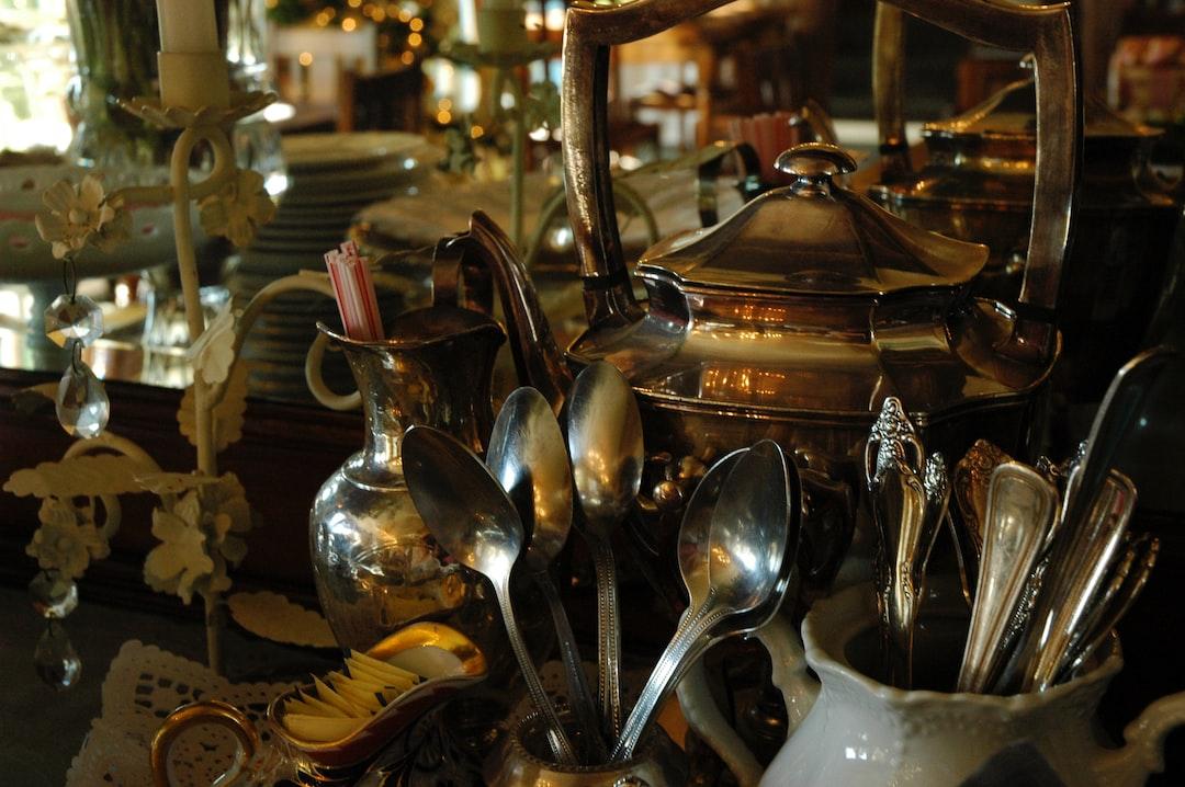 Sideboard, silver teapot, flatware, spoons, forks, sugar packets, plates, lights, mirror, dining room, Mill Rose Inn, Half Moon Bay, California, USA