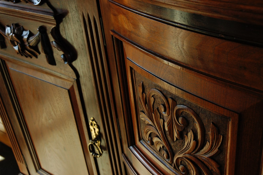 Polished carved wood ornate sideboard, dining room, Mill Rose Inn, Half Moon Bay, California, USA