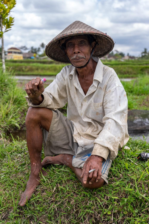 man sitting on grass during daytime