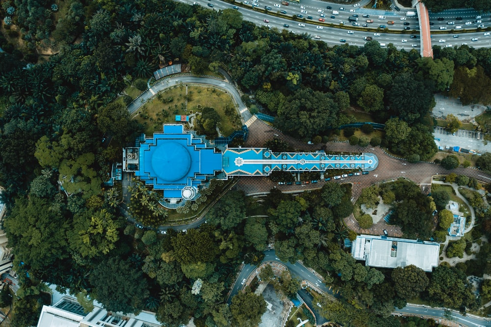 aerial photography of blue building beside trees during daytime