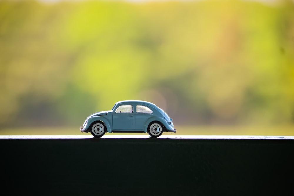 gray Volkswagen beetle toy