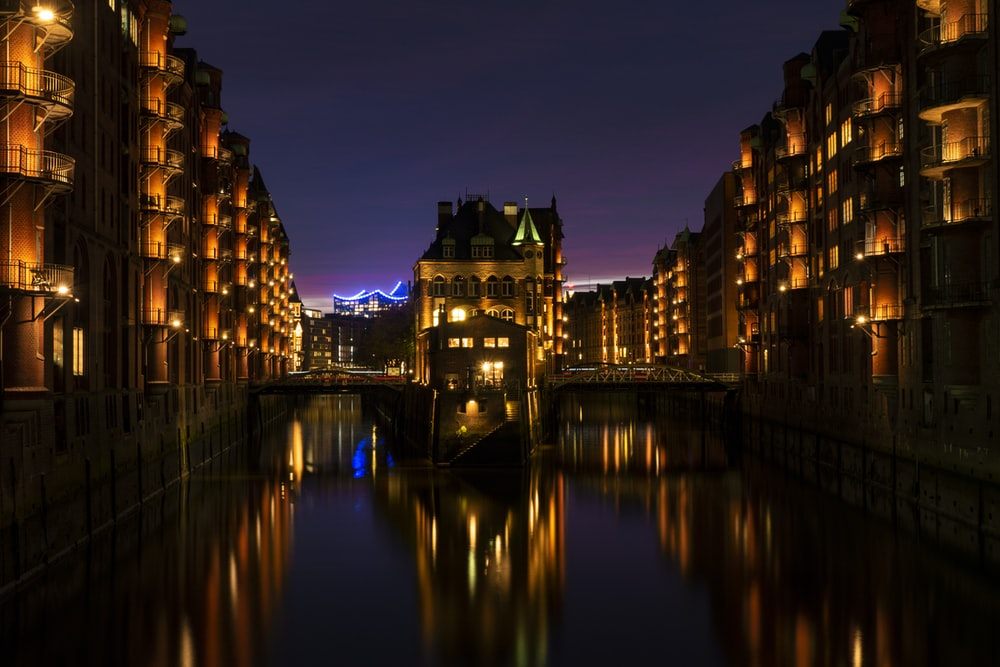 body of water beside building at night