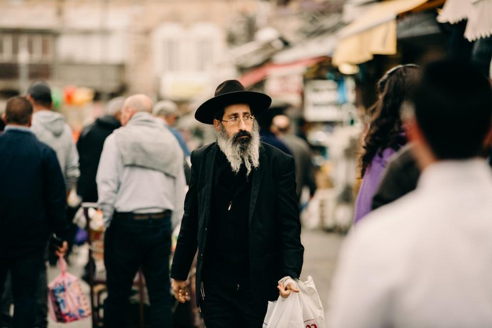 man wearing black coat and hat
