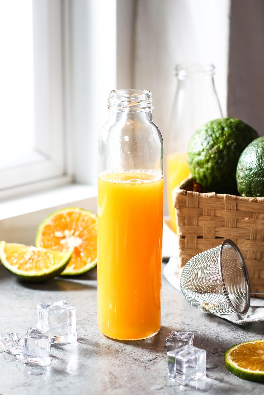 orange juice bottle beside brown wicker basket