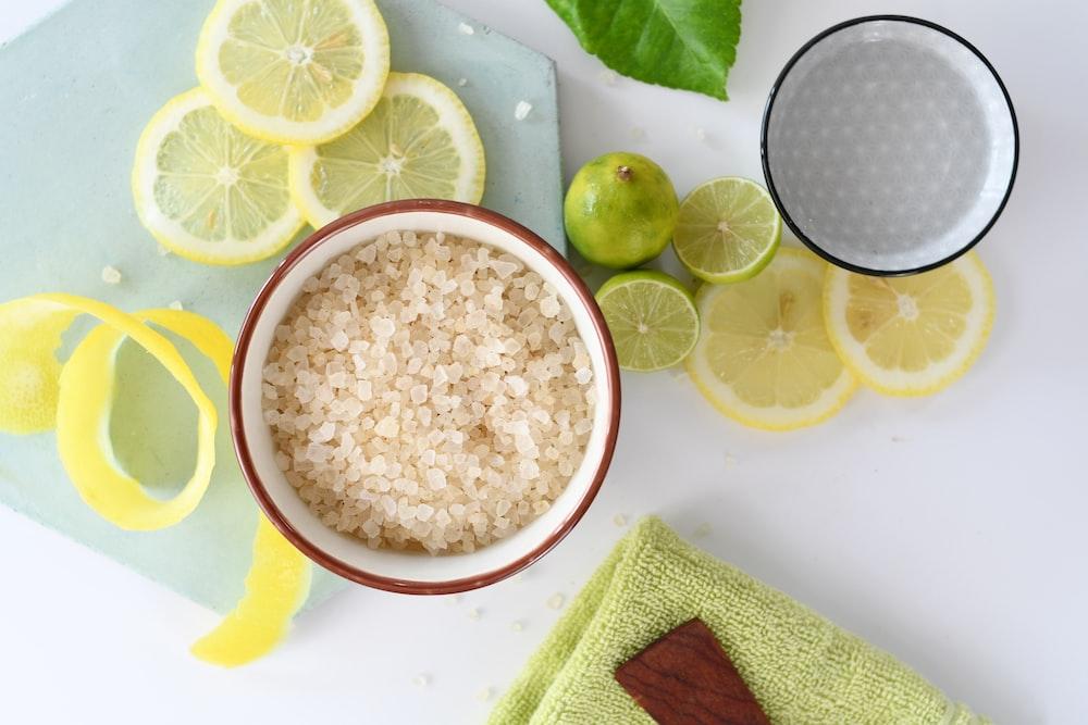 round white ceramic bowls beside sliced lemons