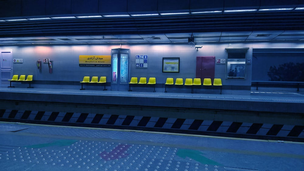 yellow gang chairs on train station