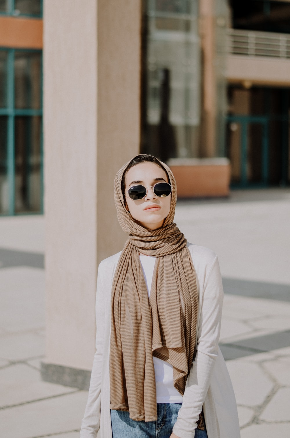 woman wearing white long-sleeved shirt and brown scarf