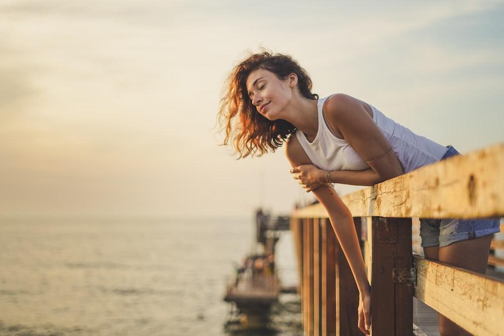 woman leaning forward on dock rail
