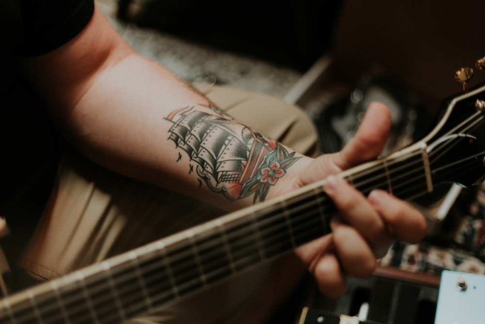 sailing ship arm tattoo