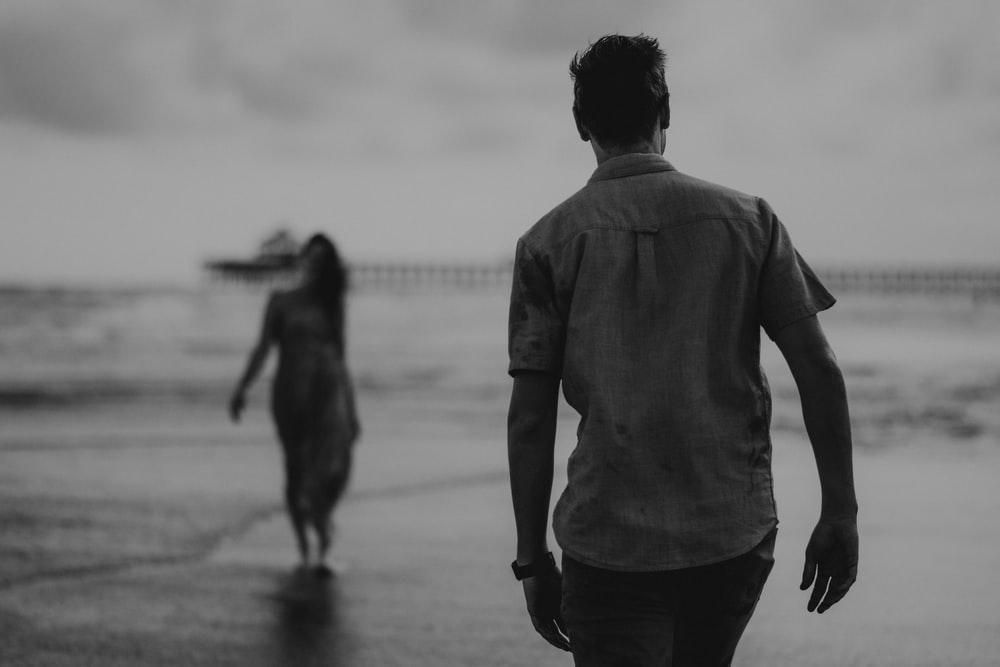 greyscale photo of man and woman