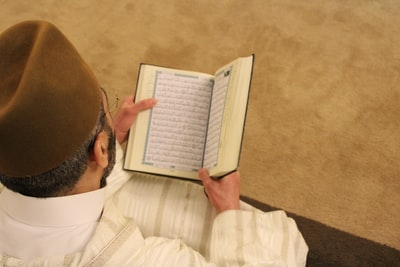 person reading open booked ramadan zoom background