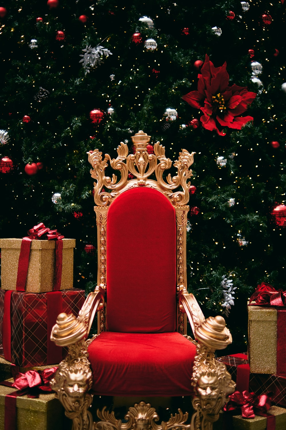 gold and red throne beside gift boxes