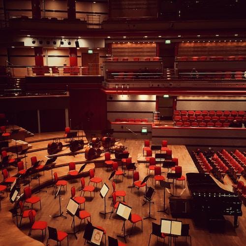 black grand piano on opera stand