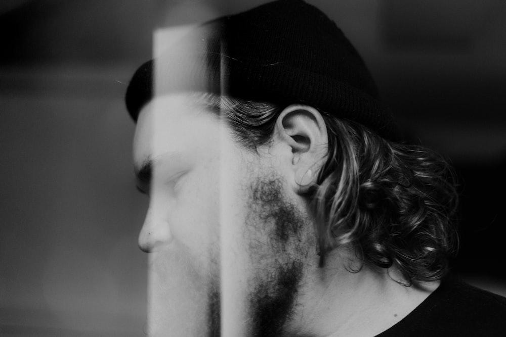 man in black shirt with beanie cap