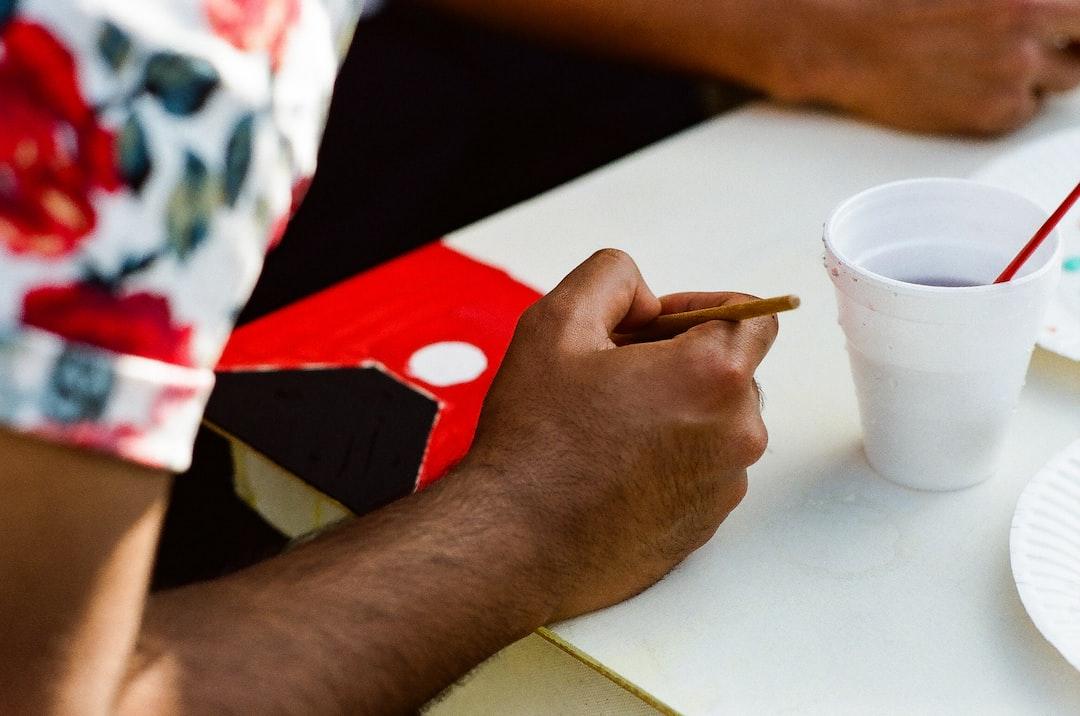 An artist making an improvised doodle on a canvas. Shot on Kodak Gold 200.