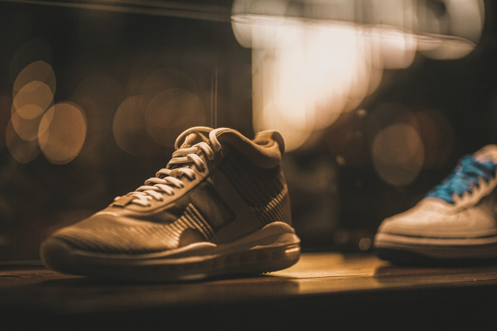 selective focus photography of white lace-up basketball shoe