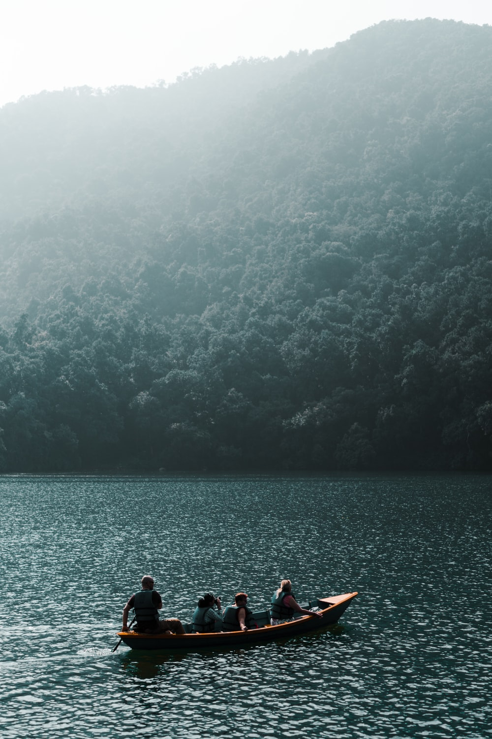 four person riding boat