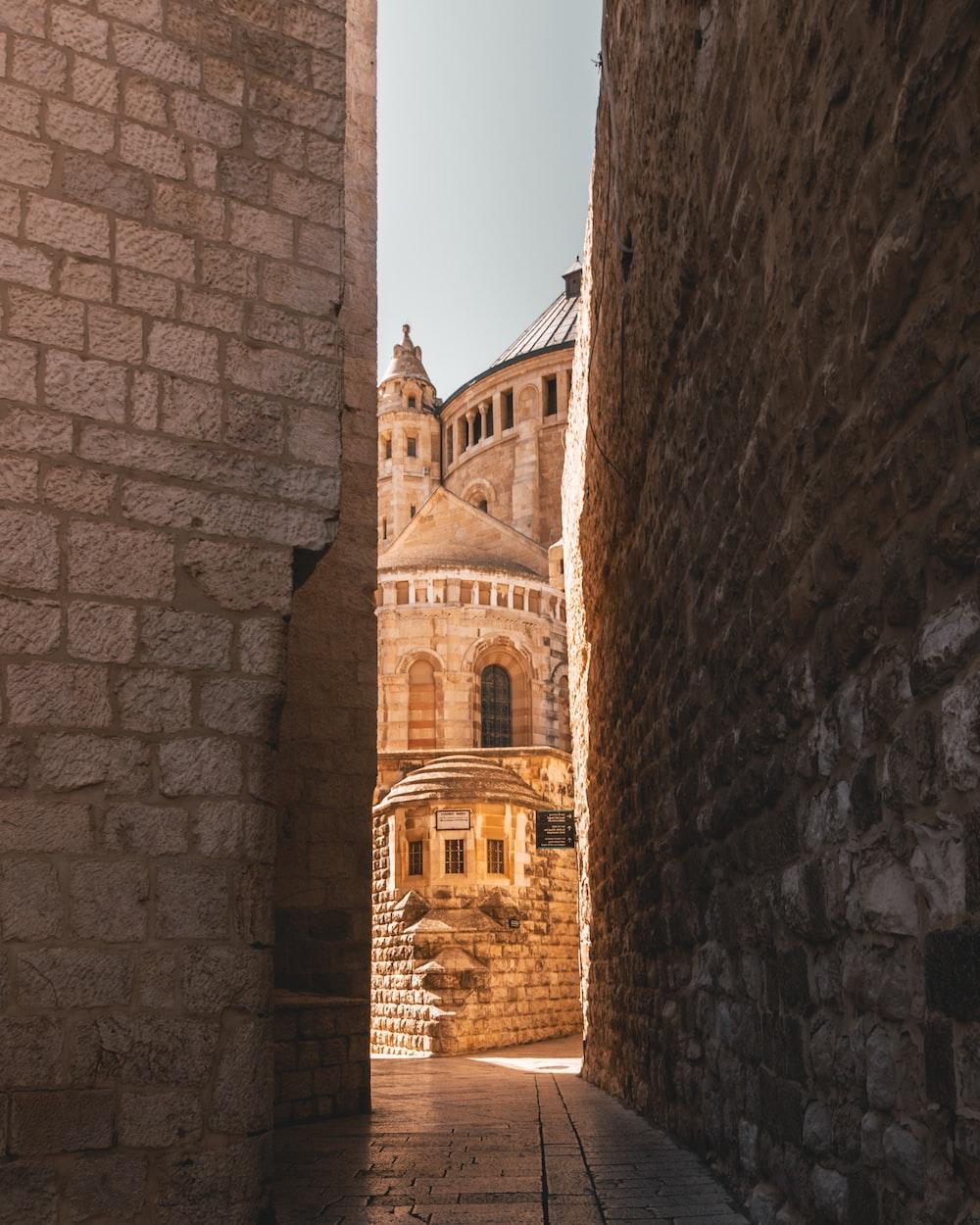 pathway in between of bricked buildings through castle