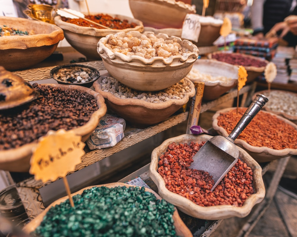 assorted spices in bowls on display stand