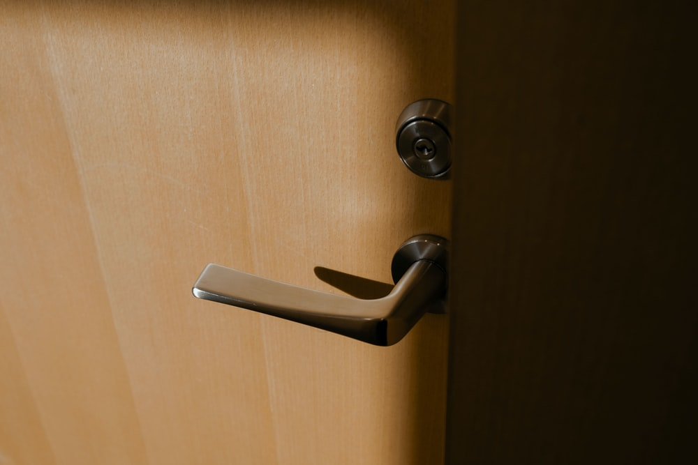 brown wooden door lever