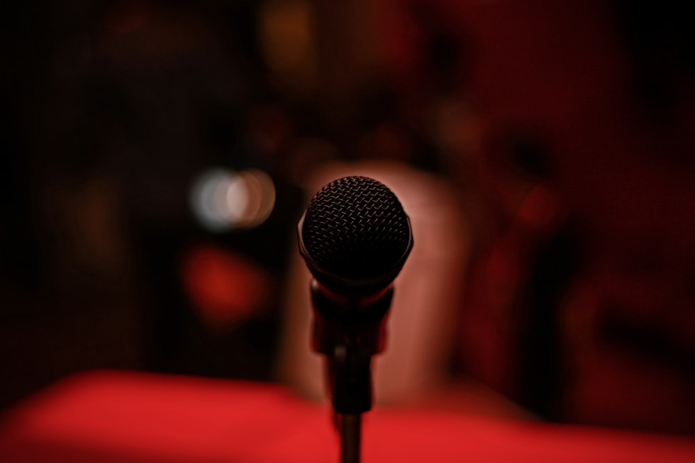 selective focus photography of black microphone