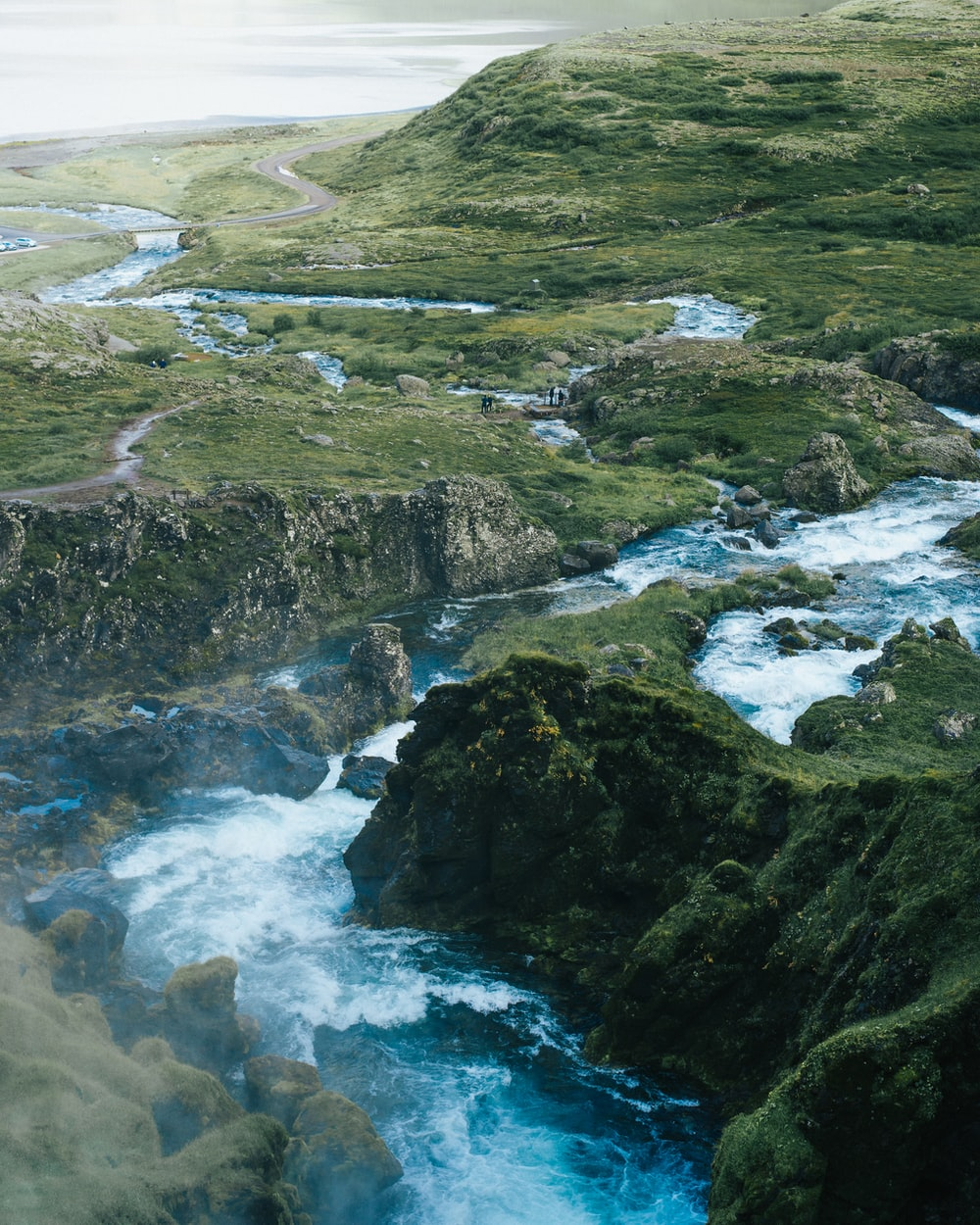 mountain ranges surrounding body of water