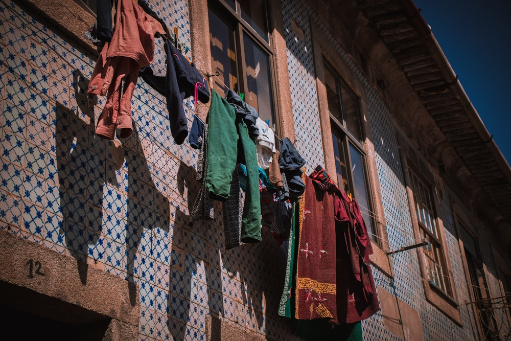 shallow focus photo of textiles hanging near window